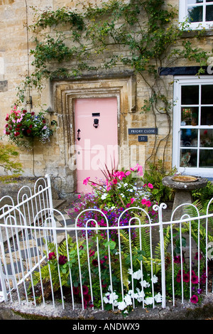 Cotswolds cottage and fenced front garden Burford Oxfordshire UK - Stock Photo