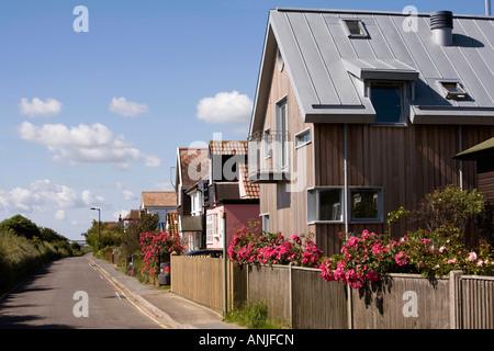 UK Suffolk Southwold properties behind sand dunes along Ferry Road - Stock Photo