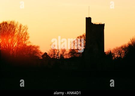 Caister Castle 15th century Norfolk landmark silhouetted against evening sky - Stock Photo