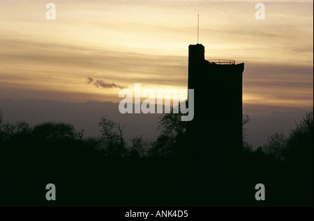Caister Castle, a 15th century Norfolk landmark, silhouetted against evening sky - Stock Photo