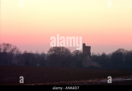 View of Caister Castle, a 15th century Norfolk landmark silhouetted against a winter evening sky - Stock Photo