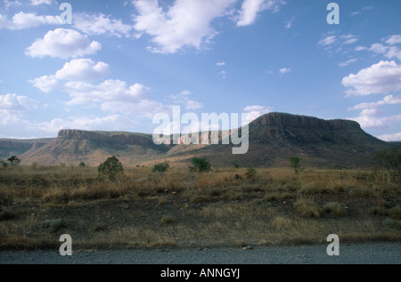 A typical scene on the road to the West in W A, looking towards the Pentecost Range in East Kimberley. - Stock Photo