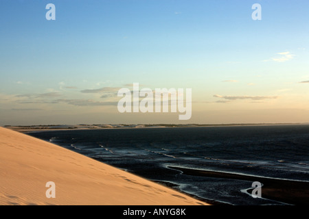 view of the big sand dune of the beautiful fisherman village of Jericoacoara in ceara state brazil - Stock Photo