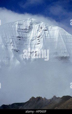 The mist enshrouded North Face of MOUNT KAILASH 6638 M is a sacred site for BUDDHIST HINDU PILGRIMS TIBET - Stock Photo