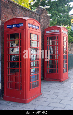 Updated telephone box next to a traditional one, Queen Street, Exeter, Devon - Stock Photo