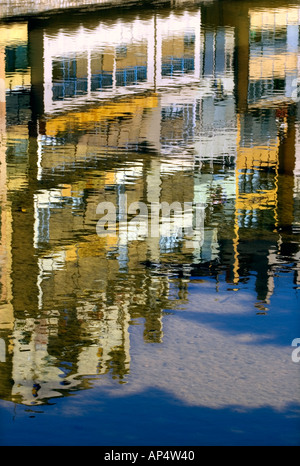 Reflections of houses and apartments overlooking the river Onyar in the historic district of Girona, Spain - Stock Photo