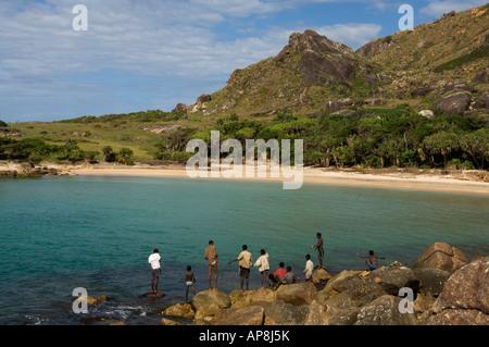 boys fishing, Lokaro Bay, near Taolagnaro, Fort Dauphin, Madagascar - Stock Photo