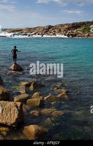boy fishing, Lokaro Bay, near Taolagnaro, Fort Dauphin, Madagascar - Stock Photo