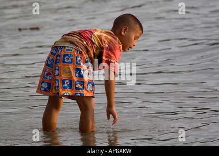 Southeast Asia Thailand Koh Chang A local child of 8 playing on the beach - Stock Photo