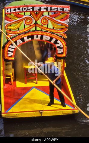 Colorful gondolas in Xochimilco Canal Mexico City Mexico - Stock Photo