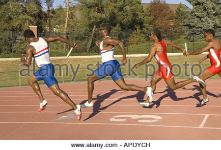 Runners racing on outdoor track - Stock Photo