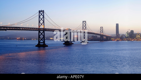 High resolution panoramic image of Bay Bridge at dusk shot from Treasure Island Copyspace on top and bottom - Stock Photo