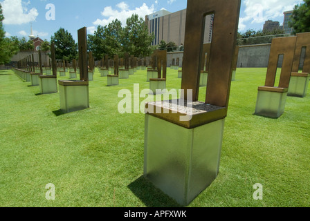 The Field of Empty Chairs on the  Oklahoma City National Memorial site of the Alfred P Murrah federal building. - Stock Photo