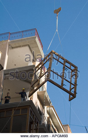 Workers installing new windows in an apartment in Carthagena Murcia Spain - Stock Photo