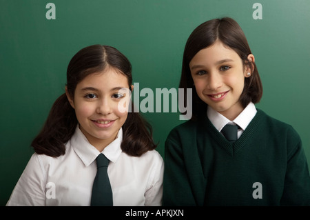 Portrait of chidren in classroom - Stock Photo