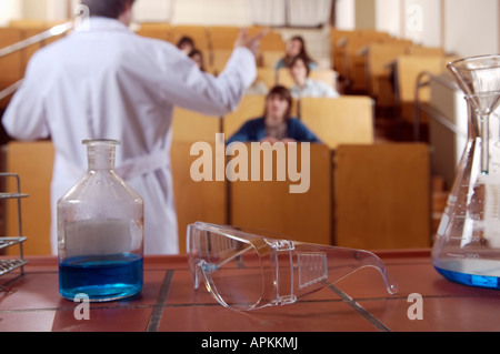 Students and teacher in classroom - Stock Photo