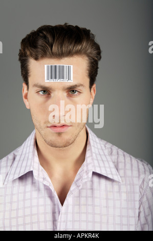 Man portrait with bar code on forehead - Stock Photo