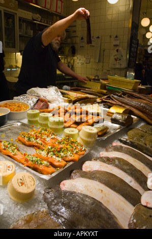 Fish stall at Östermalms Saluhall market hall in Stockholm Sweden - Stock Photo