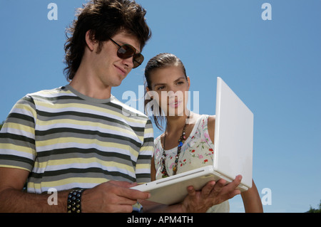 Two teenagers with notebook - Stock Photo
