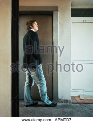 Stylish man waiting for elevator - Stock Photo