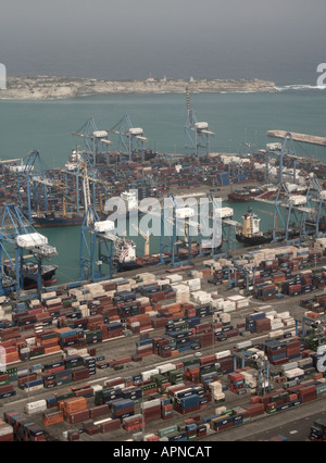 International trade. Container port and sea transport logistics hub. Aerial view of Malta Freeport in Mediterranean - Stock Photo