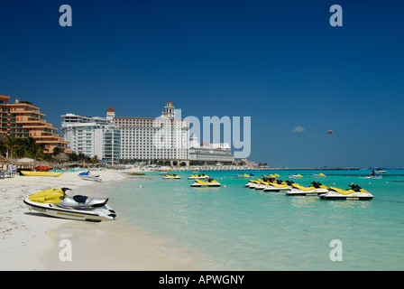 Sandy beach with jetskis in Cancun hotel and resort area, Quintana Roo State, Mexico, North America - Stock Photo