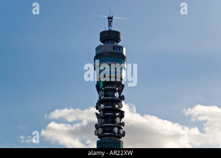 Horizontal view of the distinctive BT telecom tower against a bright blue sky in the evening sun - Stock Photo