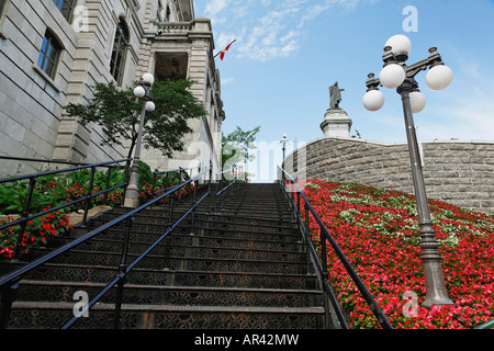 Wrought iron stairway leading outside the fortified walls of Old Quebec City - Stock Photo