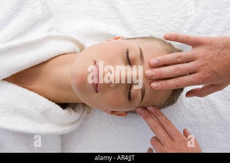 Young woman having head massage - Stock Photo