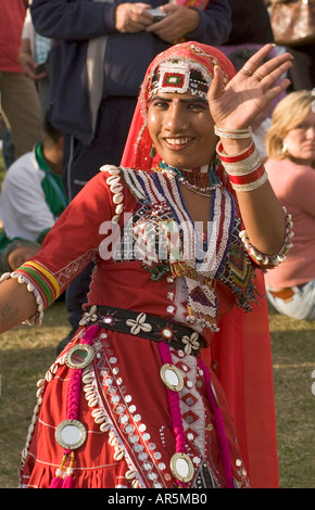 Indian dancer, tourists in the background - Stock Photo