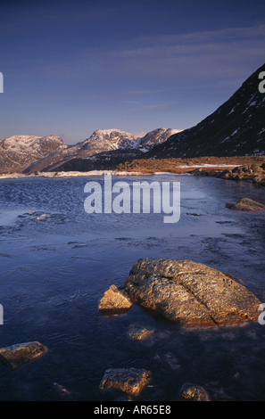 Three Tarns Bow Fell with Scafell beyond A wintry scene in Cumbria - Stock Photo