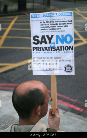 A protestor outside Southwark Town Hall demonstrating against the proposed demolition of the Aylesbury estate in - Stock Photo