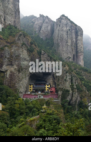 Taoist temple built in mountain side cave, Yangdang Mountains, Wenzhou, Zhejiang Province, China - Stock Photo