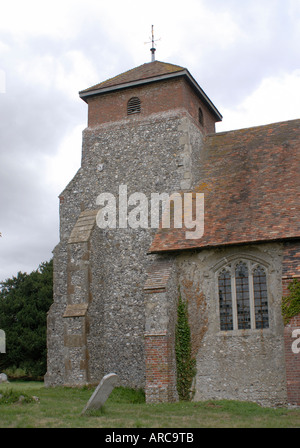 The thirteenth century church of St Peter s is built with flint stone and brick I - Stock Photo