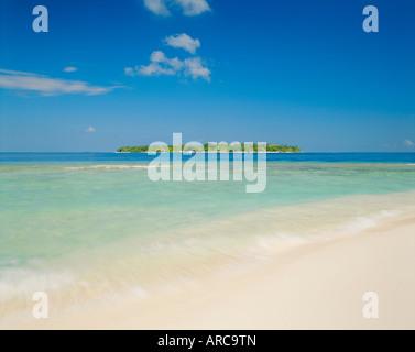The tropical island of Bandos from Kuda Bandos (Little Bandos), North Male Atoll, the Maldives, Indian Ocean - Stock Photo