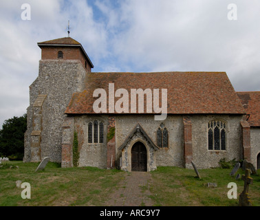 The thirteenth century church of St Peter s is built with flint stone and brick - Stock Photo