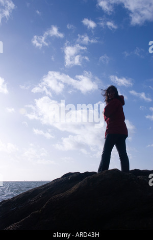Girl on a rock - Stock Photo