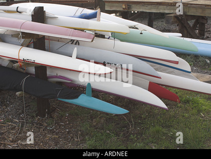 rack of kayaks rowing sculls and canoes - Stock Photo