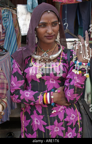 Woman in traditional Rajasthani dress, India - Stock Photo