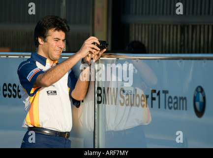 Renault Team member takes pictures of BMW Sauber box during Formula 1 Testing on Circuit Ricardo Tormo, Jan.2008 - Stock Photo