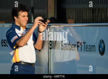 Renault Team member takes pictures of BMW Sauber box during Formula 1 Testing on Circuit Ricardo Tormo, Jan.2008 - Stock Photo