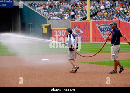 Watering or hosing down the dust on the field prior to the Detroit Tiger Professional Baseball game - Stock Photo