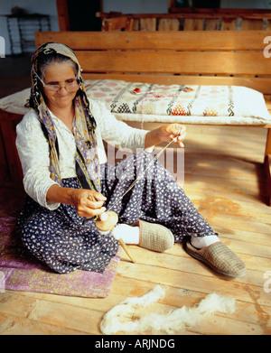Old Turkish woman sewing a mat, Kekova (Kas), Turkey, Eurasia - Stock Photo