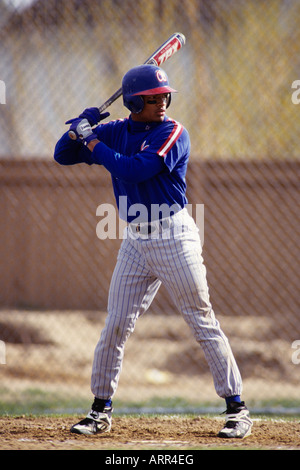 Baseball player in action batting - Stock Photo