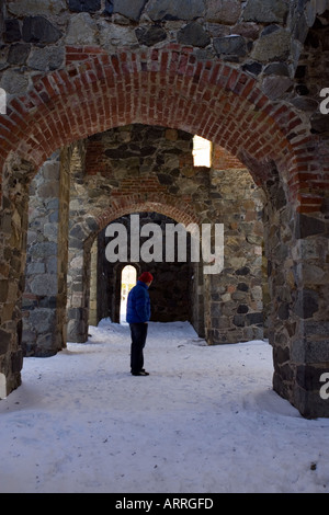 View from the ruins of St. Per's church at Sigtuna in Sweden, with snowy background. Model release available. - Stock Photo