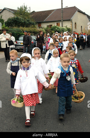 Children parade in the annual wine festival, or biou, in Pupillin, a winemaking village in France's Jura region - Stock Photo