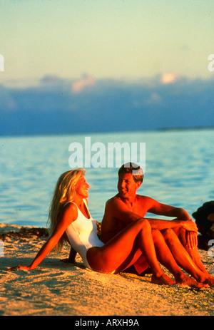 On Matira Beach at sunset on Bora Bora - Stock Photo
