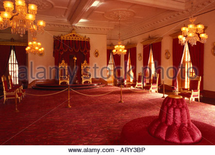 Interior throne room. 4 story Italian renaissance Iolani Palace, only royal palace in US, built in 1882 by King - Stock Photo