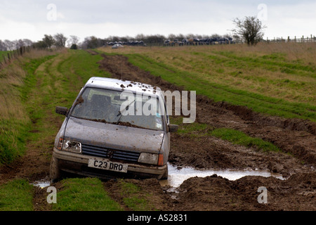 Car stuck in mud and abandoned on The Ridgeway National Trail byway in Berkshire England UK - Stock Photo