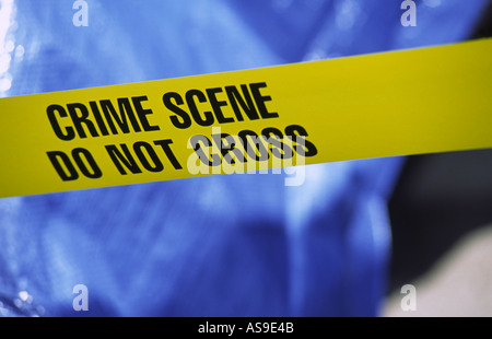 crime scene taped off with yellow police crime scene tape - Stock Photo